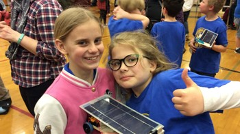 Two HHES students display their solar car