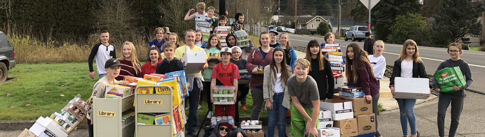 HMS students hauled food drive proceeds to fire station
