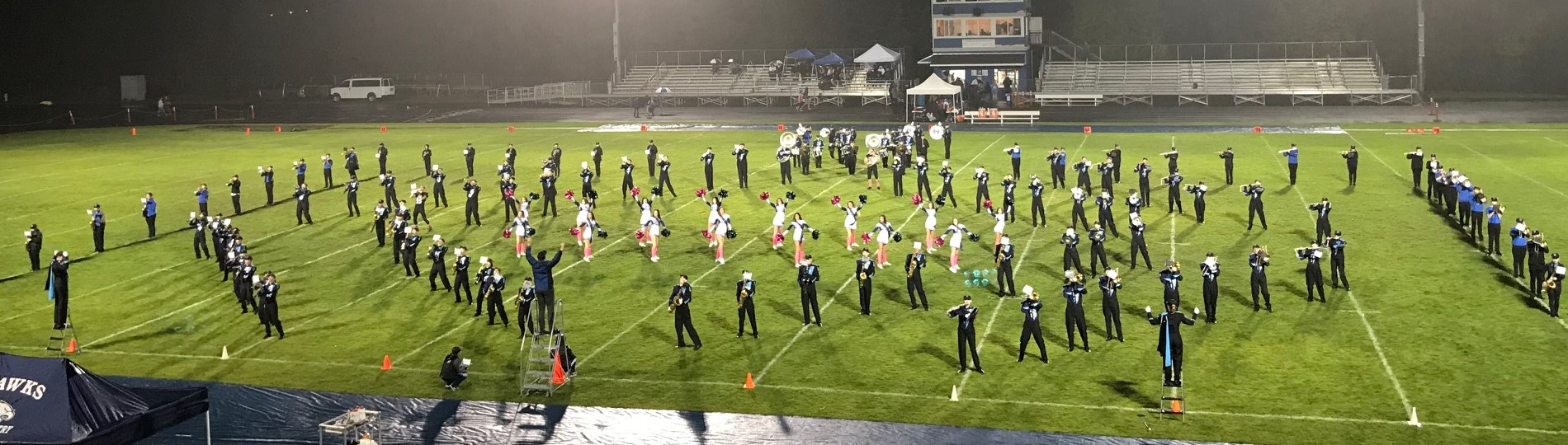 Marching band and cheerleaders performing halftime show